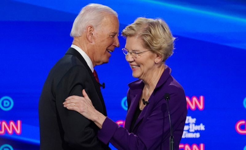 FILE PHOTO: Democratic presidential candidate and former Vice President Biden shakes hands with Senator Warren in Westerville