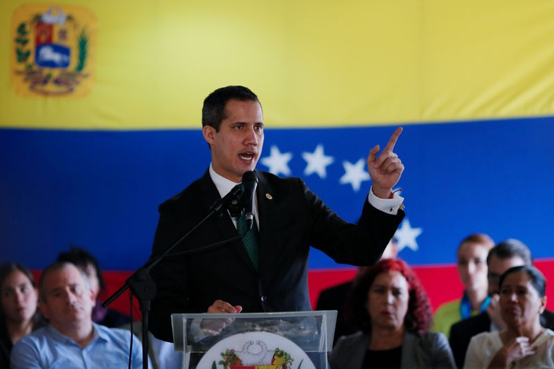 FILE PHOTO: Venezuelan opposition leader Juan Guaido, who many nations have recognised as the country's rightful interim ruler, speaks during conference in Caracas