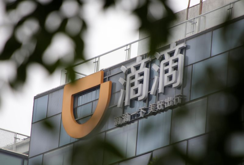 Logo of Didi Chuxing is seen at its headquarters building in Beijing