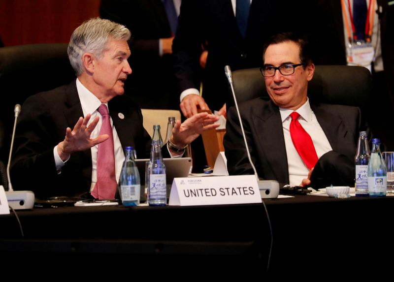 FILE PHOTO: Federal Reserve Chairman Jerome Powell talks with U.S. Treasury Secretary Steven Mnuchin during the G20 finance ministers and central bank governors meeting in Fukuoka