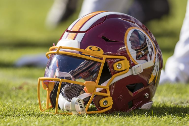 FedEx, which paid $205 million for naming rights to the Washington Redskins' stadium, asks team to change its name