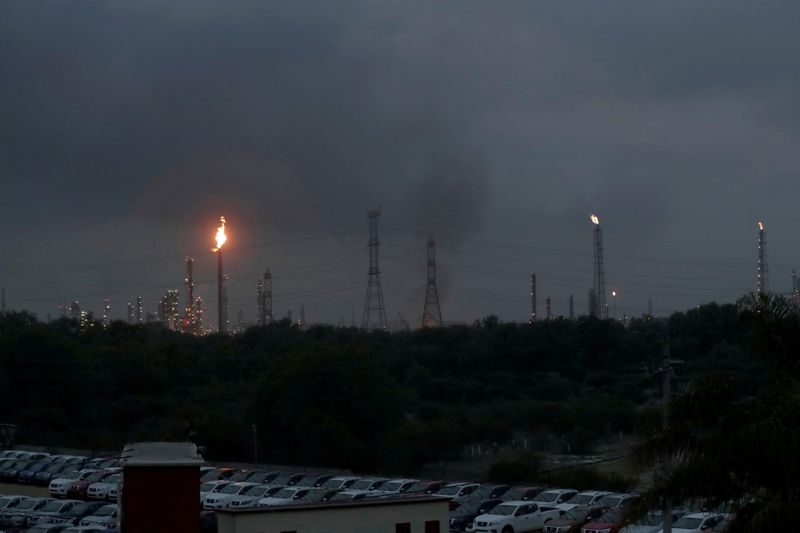 Excess natural gas is burnt, or flared, from Mexican state-owned Pemex's Tula oil refinery, located adjacent to the Tula power plant belonging to national power company Comisión Federal de Electricidad, or CFE, in Tula de Allende