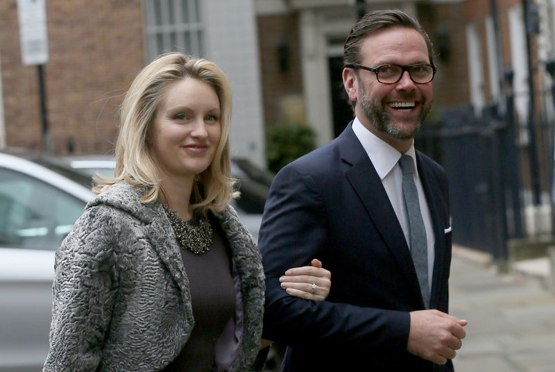 FILE PHOTO: James Murdoch, the son of media mogul Rupert Murdoch, and his wife Kathryn Hufschmid arrive for a reception to celebrate the wedding between Rupert Murdoch and former supermodel Jerry Hall which took place on Friday, in London