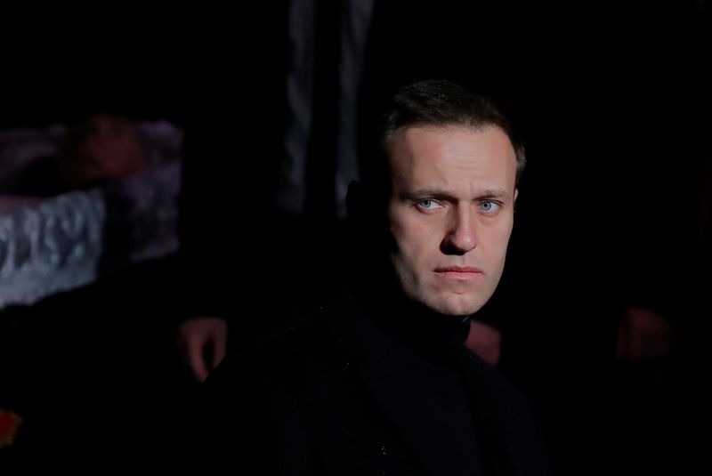 FILE PHOTO: Russian opposition leader Navalny pays respect to human rights activist Alexeyeva in Moscow