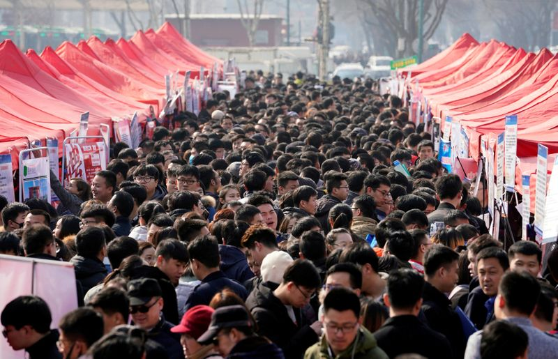 Job seekers crowd a job fair at Liberation Square in Shijiazhuang