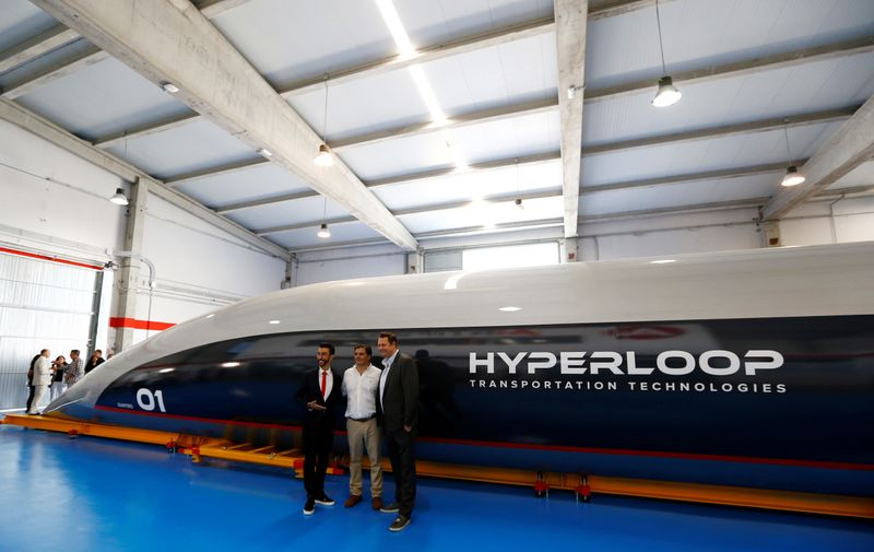 FILE PHOTO: Hyperloop TT co-founder and CEO, Dirk Ahlborn, Airtificial co-founder and chairman, Rafael Contreras and Hyperloop TT chairman and co-founder, Bibop Gresta pose next to the world's first full-scale passenger Hyperloop capsule during its present