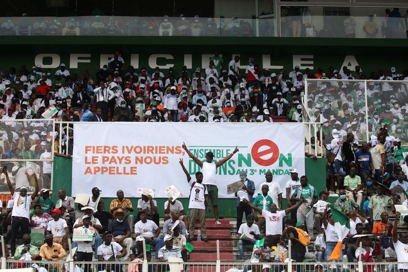 Supporters of Ivory Coast's opposition coalition parties gather during a stadium rally, in Abidjan