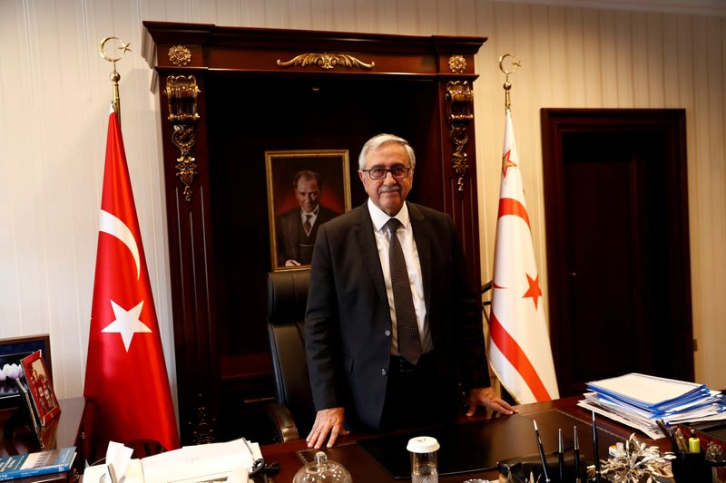 FILE PHOTO: Turkish Cypriot leader Akinci poses at his office in Nicosia
