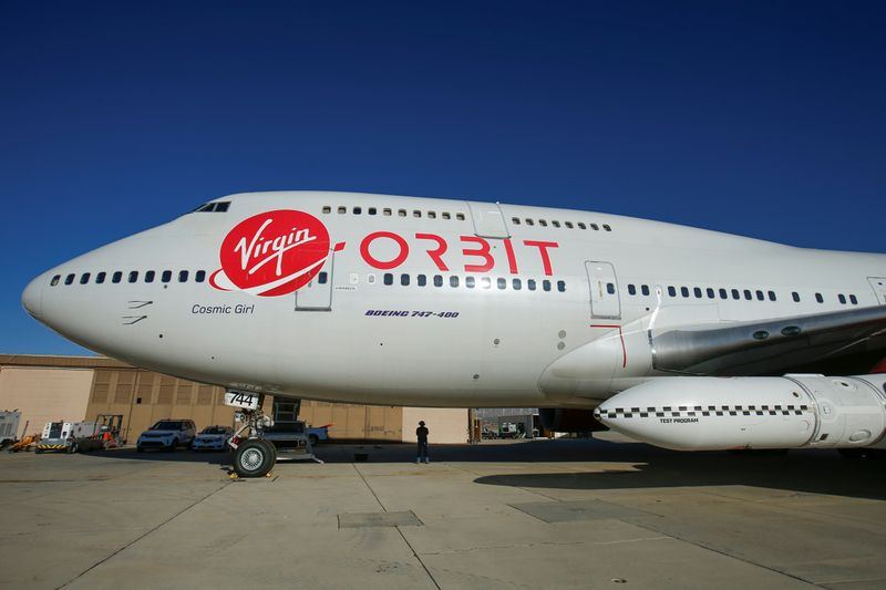 Richard Branson's Virgin Orbit, with a rocket underneath the wing of a modified Boeing 747 jetliner, prior to its takeoff on a key drop test of its high-altitude launch system for satellites from Mojave, California