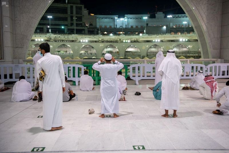 Muslims pray in the Grand Mosque for the first time in months since COVID-19 restrictions were imposed