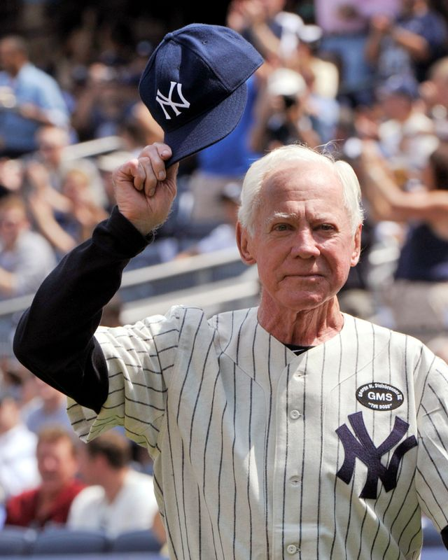 FILE PHOTO: Hall of Fame member Whitey Ford tips his cap during introductions for the New York Yankees 64th Old-Timers' Day game in New York