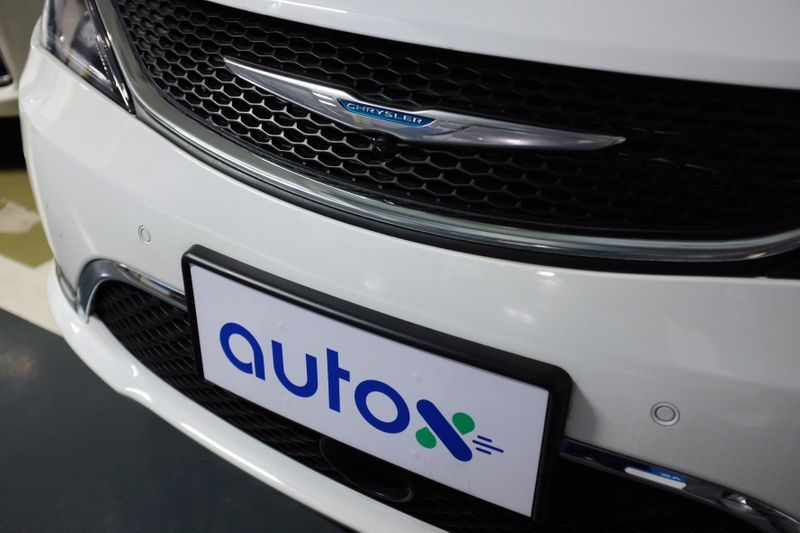 Sign of Alibaba-backed autonomous driving startup AutoX is seen on a modified Chrysler Pacifica minivan in Shenzhen