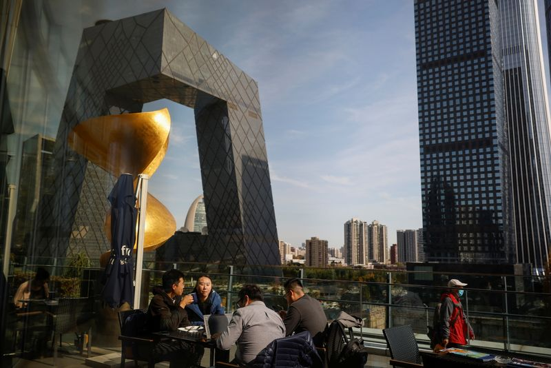 People eat lunch at a terrace restaurant near the CCTV building in the Central Business District (CBD) following an outbreak of the coronavirus disease (COVID-19) in Beijing