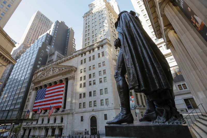 The statue of former U.S. President George Washington stands across the New York Stock Exchange (NYSE) following Election Day in Manhattan, New York City
