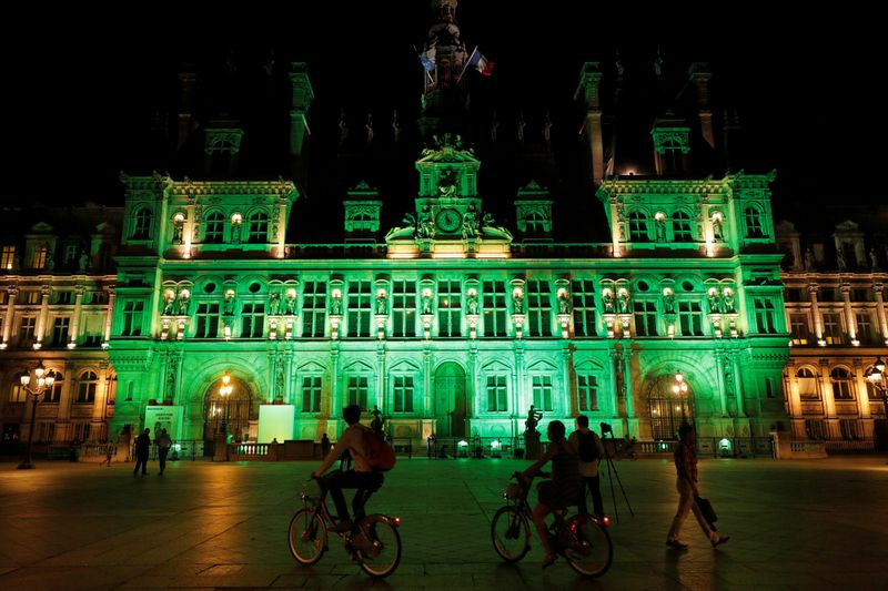 FILE PHOTO: Green lights are projected onto the facade of the Hotel de Ville in Paris, France, after U.S. President Donald Trump announced his decision that the United States will withdraw from the Paris Climate Agreement