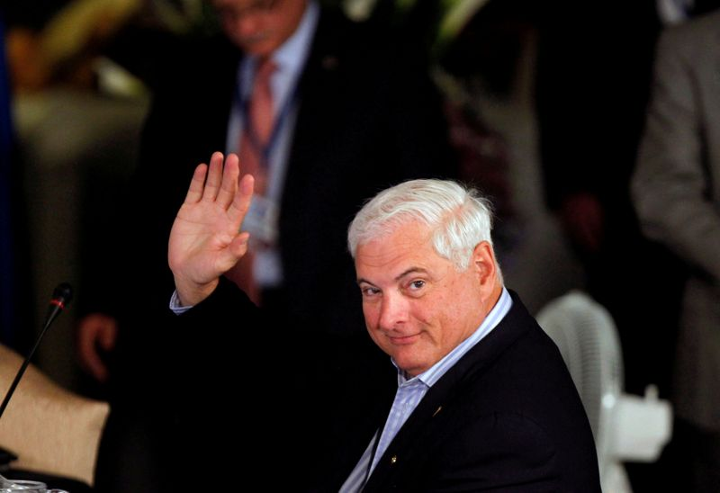 FILE PHOTO: Panamanian President Ricardo Martinelli waves during an anti-drugs summit at the Santo Domingo Hotel in Antigua