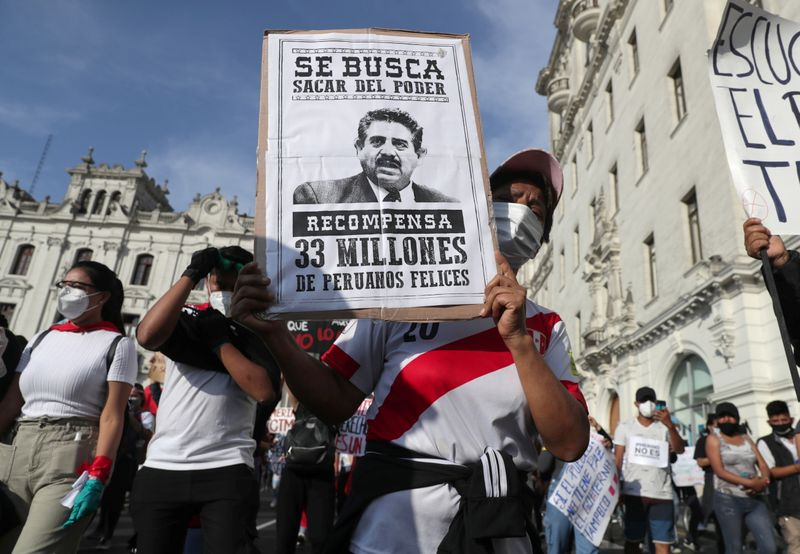 Peruvians protest against the decision of Congress to remove former President Martin Vizcarra, in Lima