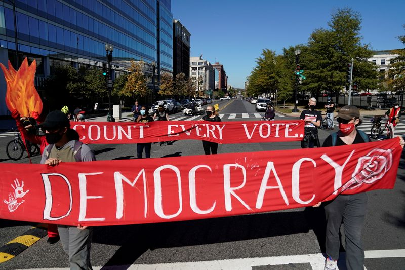 Activists take part in a protest led by shutdownDC the day after the 2020 U.S. presidential election in Washington