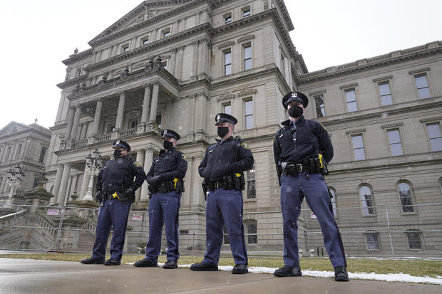 Small protests held at heavily guarded state Capitols