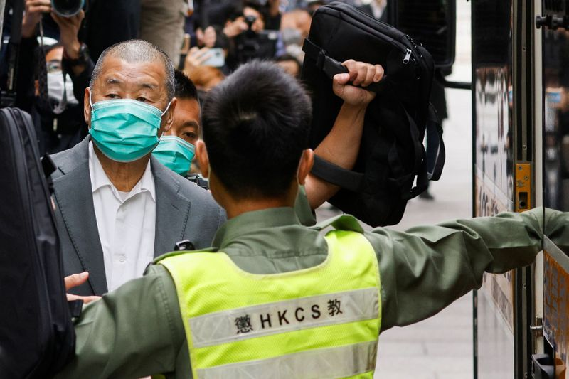 Media mogul Jimmy Lai, founder of Apple Daily, leaves the Court of Final Appeal by prison van in Hong Kong