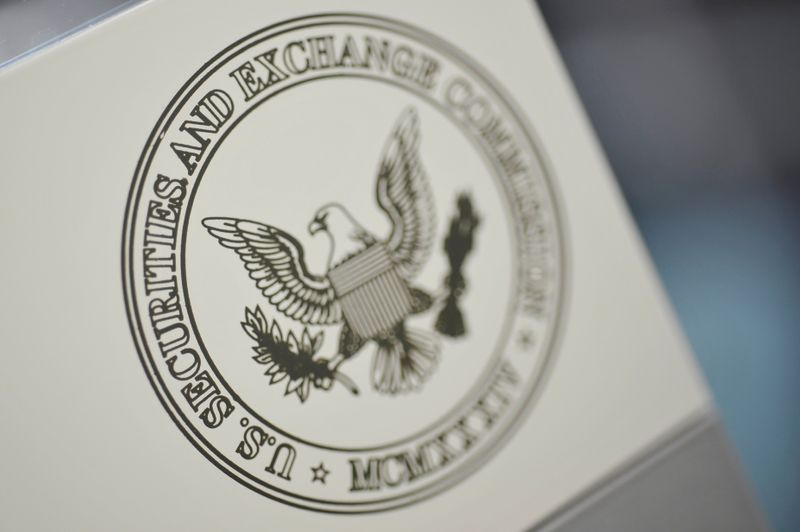 FILE PHOTO: FILE PHOTO: The U.S. Securities and Exchange Commission logo adorns an office door