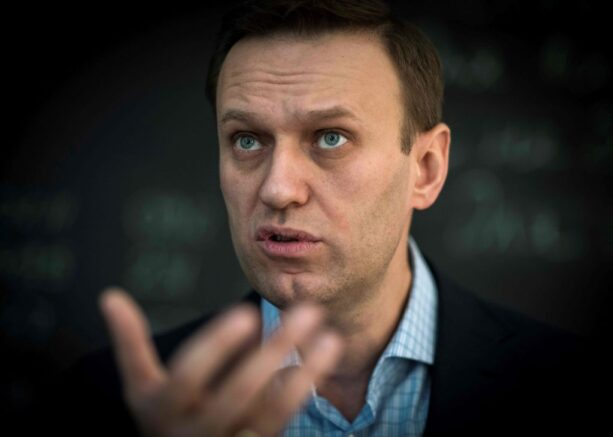 """TOPSHOT - Russian opposition leader Alexei Navalny speaks during an interview with AFP at the office of his Anti-corruption Foundation (FBK) in Moscow on January 16, 2018. - The Kremlin's top critic Alexei Navalny has slammed Russia's March presidential election, in which he is barred from running, as a sham meant to """"re-appoint"""" Vladimir Putin on his way to becoming """"emperor for life"""". (Photo by Mladen ANTONOV / AFP) (Photo by MLADEN ANTONOV/AFP via Getty Images)"""