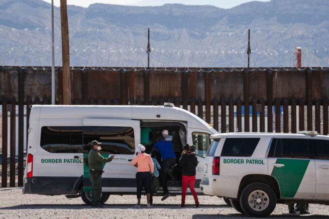 "Border Patrol agents apprehend a group of migrants near downtown El Paso, Texas following the congressional border delegation visit on March 15, 2021. - President Joe Biden faced mounting pressure Monday from Republicans over his handling of a surge in migrants -- including thousands of unaccompanied children -- arriving at the US-Mexican border. Republican Congressman Kevin McCarthy of California, who leads his party in the House of Representatives, told reporters last week the ""crisis at the border is spiraling out of control.""""It's entirely caused by the actions of this administration,"" said McCarthy. (Photo by Justin Hamel / AFP) (Photo by JUSTIN HAMEL/AFP via Getty Images)"