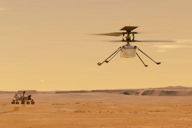 FILE - This illustration made available by NASA depicts the Ingenuity helicopter on Mars which was attached to the bottom of the Perseverance rover, background left. It will be the first aircraft to attempt controlled flight on another planet. (NASA/JPL-Caltech via AP)