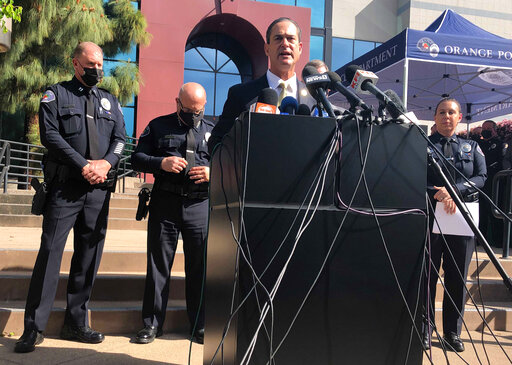 Orange County District Attorney Todd Spitzer talks during a news conference at the Orange Police Department headquarters in Orange, Calif., Thursday, April 1, 2021. A child was among four people killed Wednesday in a shooting at a Southern California office building that left a fifth victim wounded and the gunman critically injured, police said. (AP Photo/Stefanie Dazio)