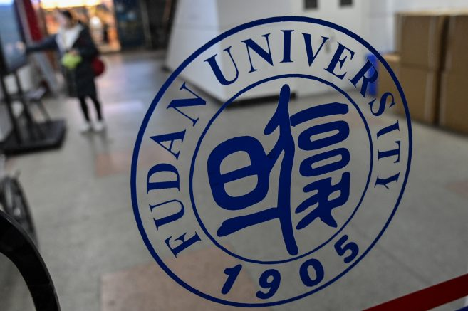 """In this picture taken on December 18, 2019, a Fudan University sign is seen on the campus in Shanghai. - One of China's top universities has removed references to """"freedom of thought"""" from its official charter, triggering a rare act of student defiance, while two other institutions have moved to strengthen their allegiance to President Xi Jinping. Video that circulated this week showed students at Shanghai's Fudan University gathering to sing the school song -- which extols """"academic independence and freedom of thought"""" -- in an apparent protest against the move. (Photo by HECTOR RETAMAL / AFP) (Photo by HECTOR RETAMAL/AFP via Getty Images)"""