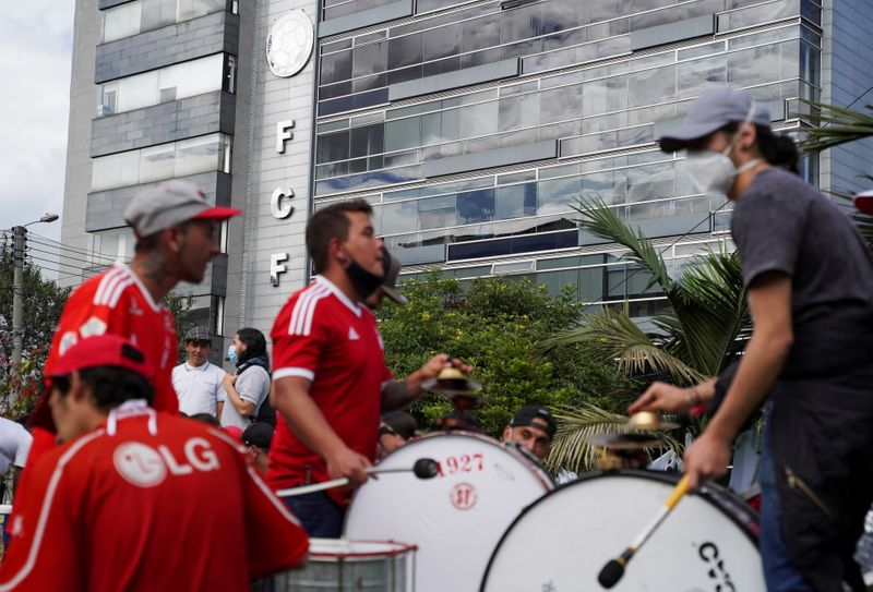 Soccer fans play the drums during a sit-in, in front of the Colombian Football Federation (FCF), in Bogota