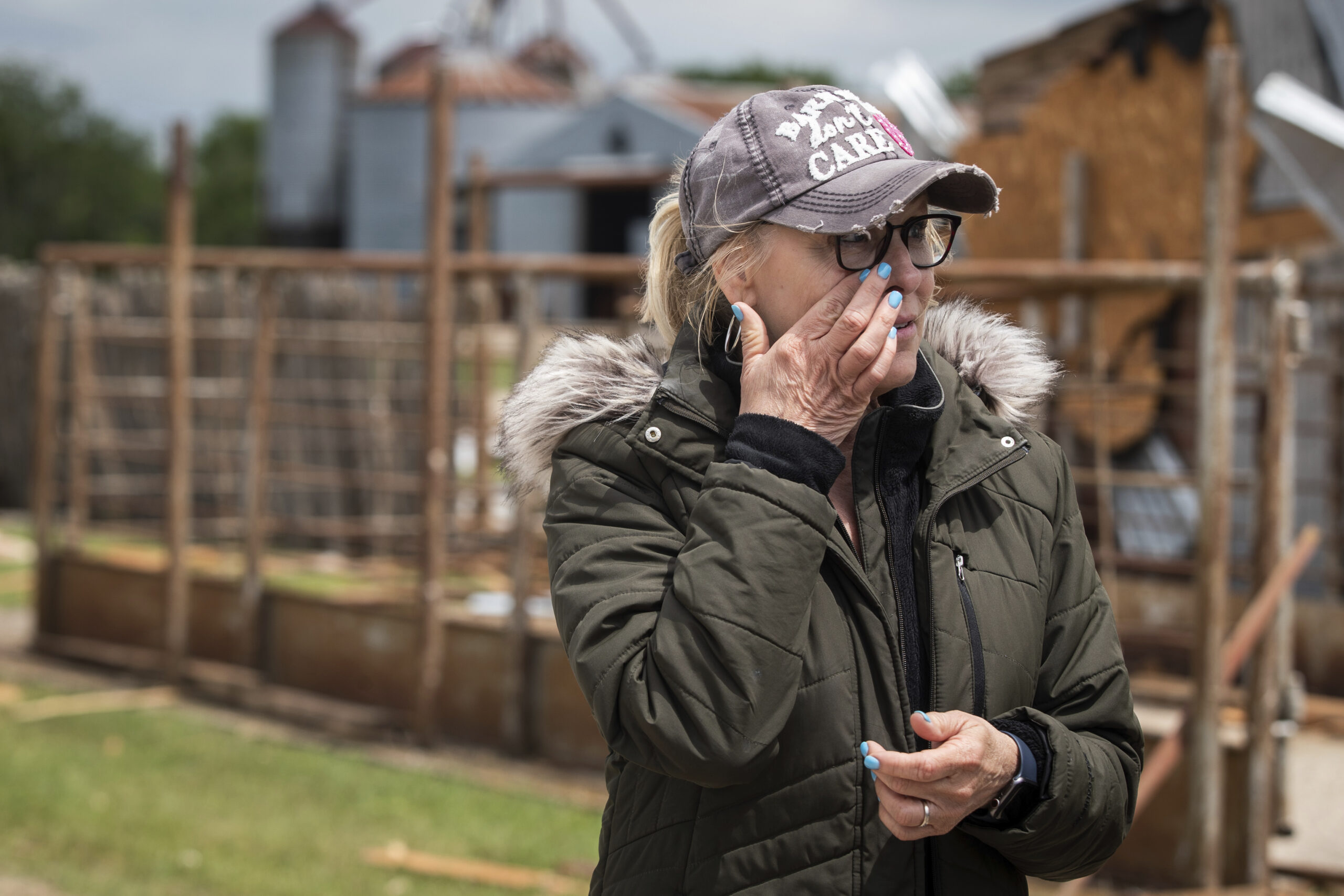 Cathy Haley wipes away tears while looking over damage caused by a tornado Tuesday, May 4, 2021, at Barn on the Brazos in Blum, Texas. (Yffy Yossifor/Star-Telegram via AP)