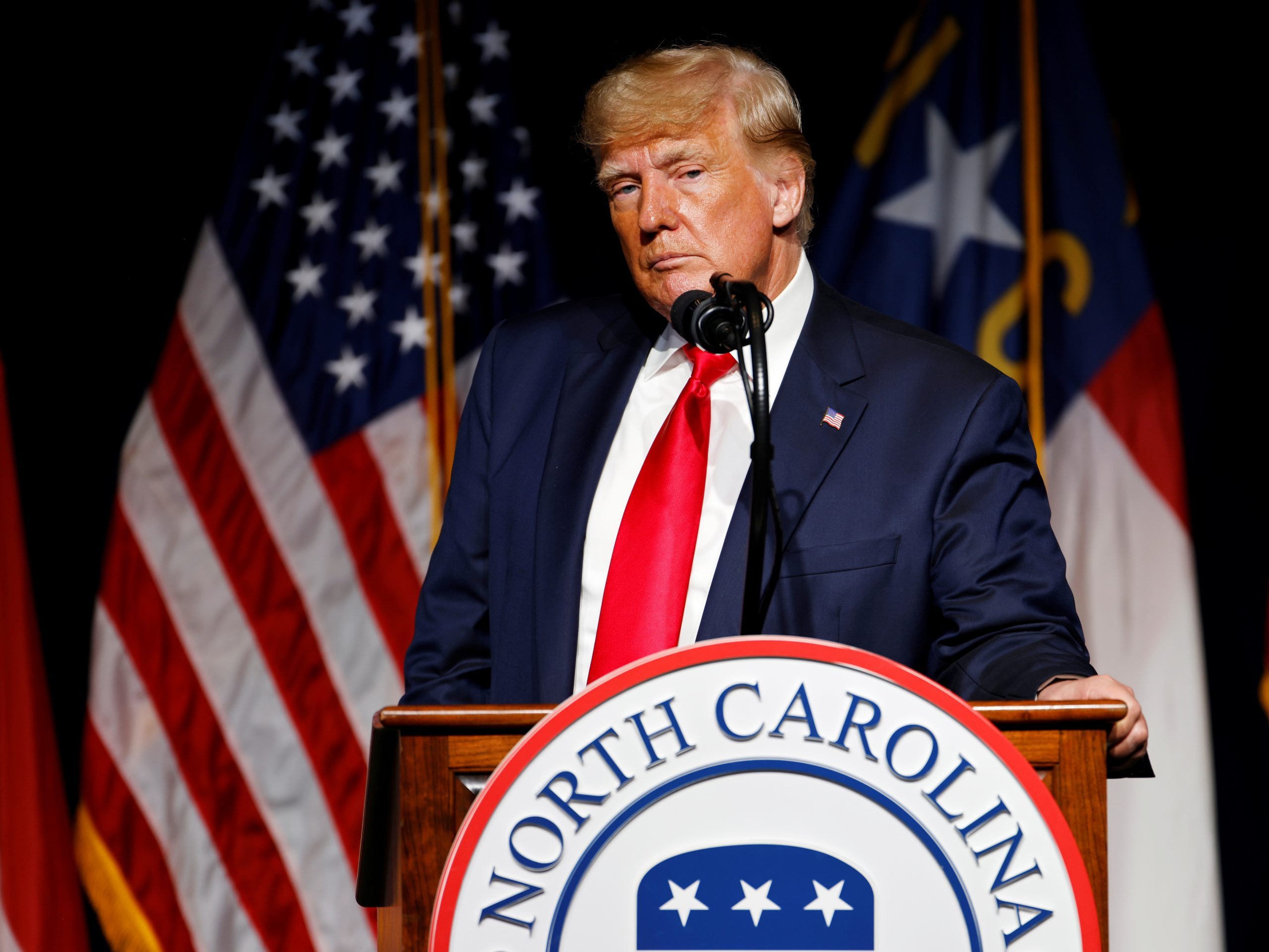 FILE PHOTO: Former U.S. President Donald Trump pauses while speaking at the North Carolina GOP convention dinner in Greenville