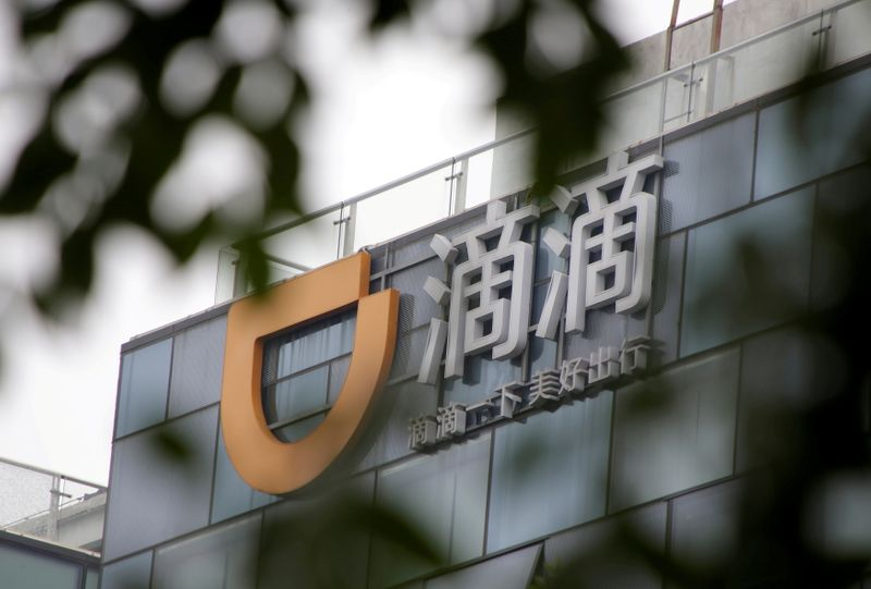 FILE PHOTO: Logo of Didi Chuxing is seen at its headquarters building in Beijing