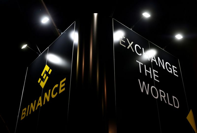 FILE PHOTO: The logo of Binance is seen on their exhibition stand at the Delta Summit, Malta's official Blockchain and Digital Innovation event promoting cryptocurrency, in Ta' Qali