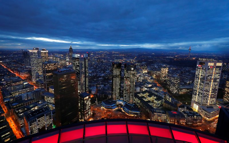 FILE PHOTO: The financial district with the headquarters of Germany's largest business bank, Deutsche Bank (C), is photographed on early evening in Frankfurt