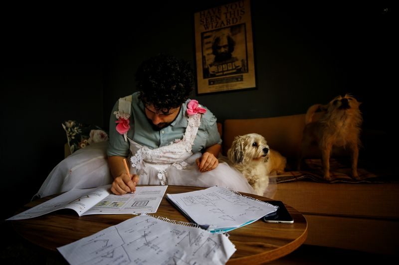 Cayan Hakiki studies for the university entrance exams at her home in Ankara