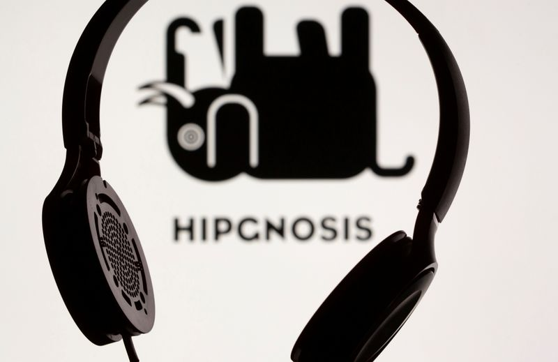 FILE PHOTO: Headset seen in front of displayed Hipgnosis logo in this illustration