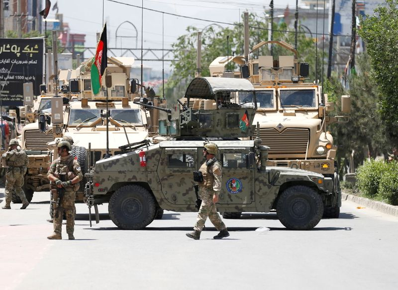 FILE PHOTO: Afghan security forces stand guard outside a hospital which came under attack in Kabul