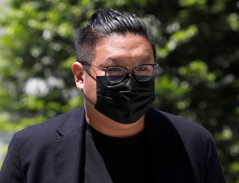 FILE PHOTO: Ng Yu Zhi, a director of Envy Global Trading, arrives at the State Court in Singapore