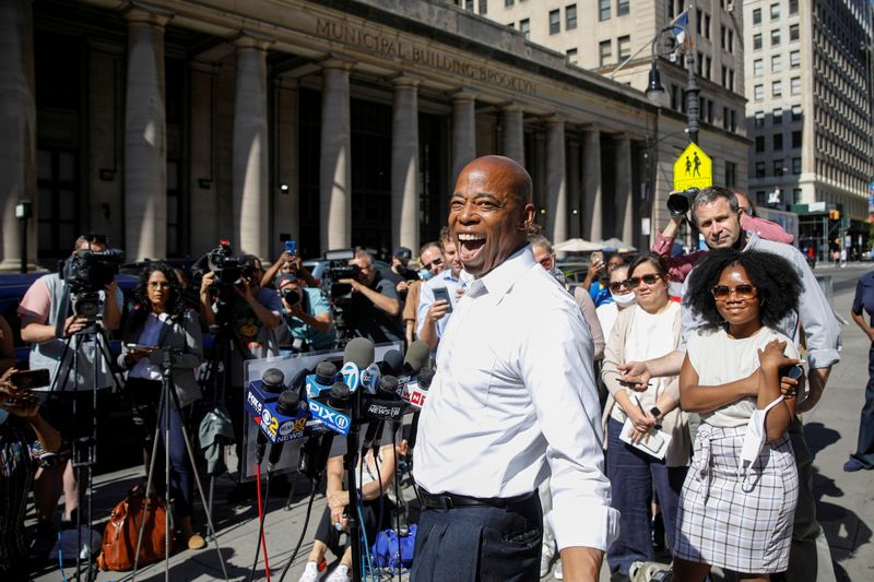 FILE PHOTO: Eric Adams speaks during a news conference outside Brooklyn borough hall in Brooklyn, New York