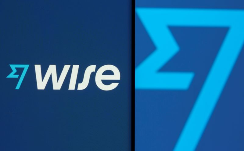 FILE PHOTO: Wise logo is seen on a smartphone in front of a displayed detail of the same logo