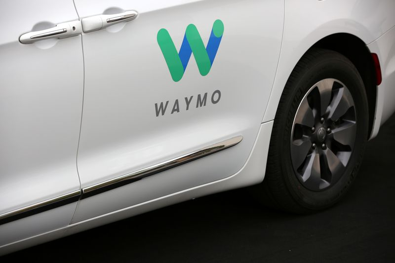 A Waymo Chrysler Pacifica Hybrid self-driving vehicle is parked and displayed during a demonstration in Chandler, Arizona