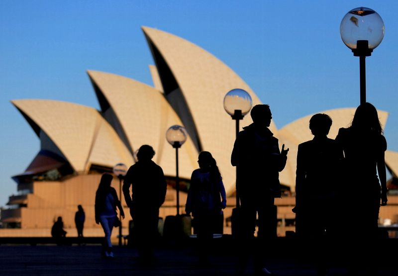 FILE PHOTO: People are silhouetted against the Sydney Opera House at sunset in Australia