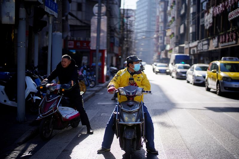 FILE PHOTO: A Meituan delivery worker wearing a face mask is seen on a street following an outbreak of the coronavirus disease (COVID-19) in Shanghai