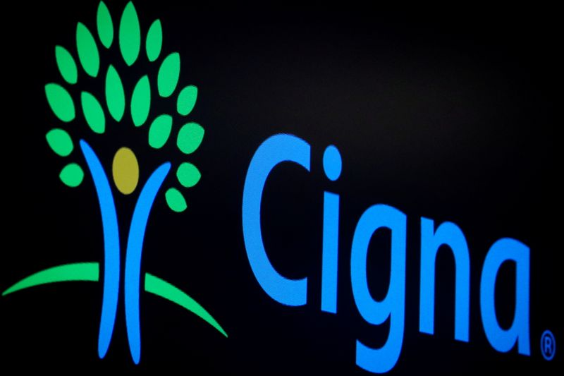 FILE PHOTO: A screen displays the logo for Cigna Corp. on the floor at the NYSE in New York