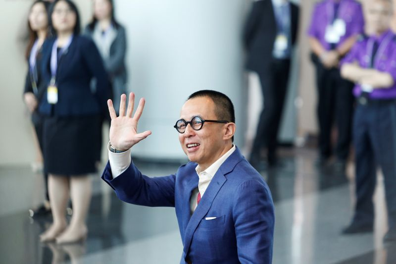 Richard Li, Hong Kong businessman and younger son of tycoon Li Ka-shing, waves as he arrives to vote during the election for Hong Kong's next Chief Executive in Hong Kong