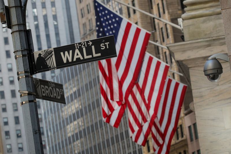 A Wall St. sign is seen outside the NYSE in New York