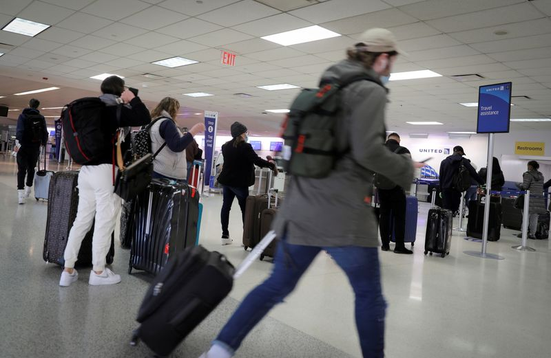 FILE PHOTO: Travelers at Newark International Airport ahead of Thanksgiving holiday in Newark, New Jersey