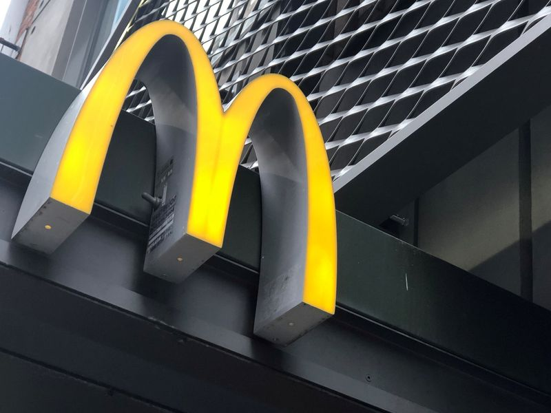 FILE PHOTO: The McDonald's logo is seen outside the fast-food chain McDonald's in New York